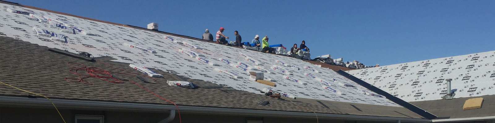 Roofing Company working on a residential roof in Shakopee, MN