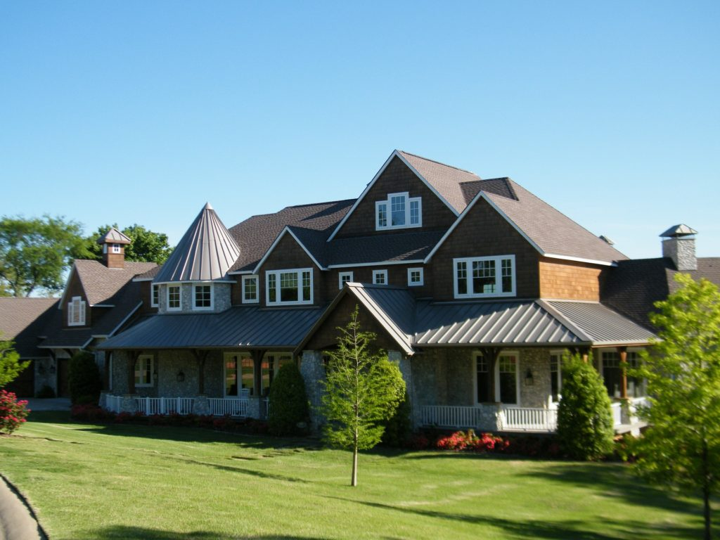 large home with metal roofing